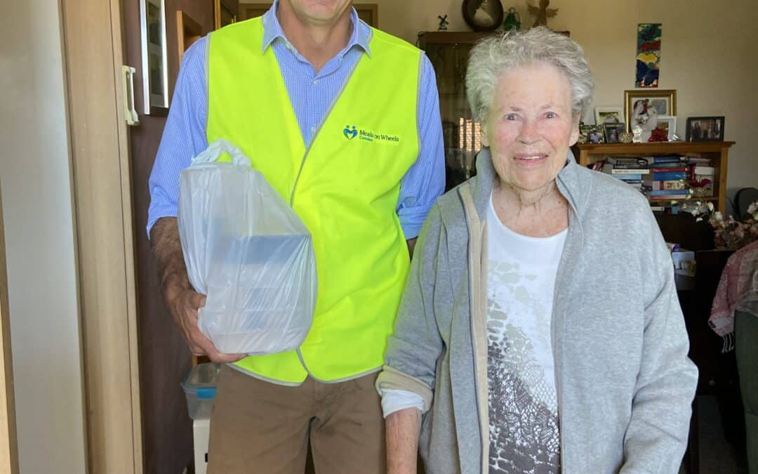 Angus Taylor meets client Joan on meal delivery
